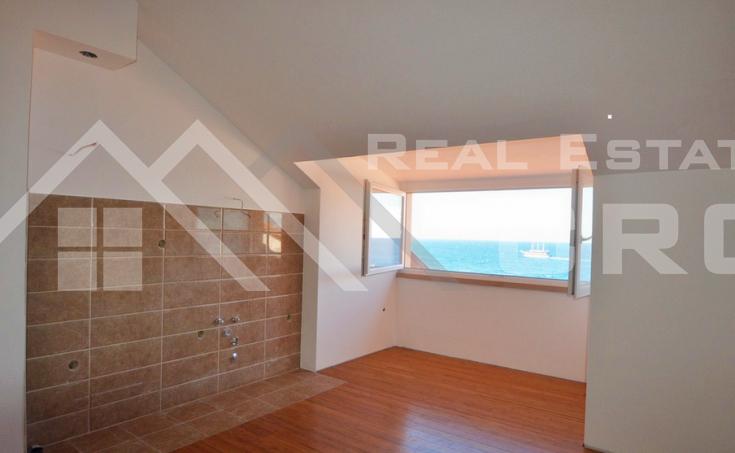 Brac properties - Three-bedroom waterfront apartment for sale in Postira, island Brac